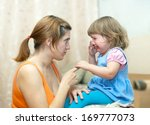 woman berates crying baby in... | Shutterstock . vector #169777073