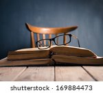 Old Books And Glasses  On A...
