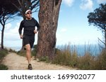 ocean trail running man doing... | Shutterstock . vector #169902077