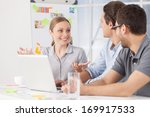 brainstorming. three young... | Shutterstock . vector #169917533