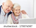 Happy Senior Couple Surfing Th...