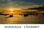 Silhouette Of Fishermen On The...