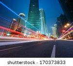 asphalt road and modern city | Shutterstock . vector #170373833