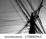 Chaotic Wire On Pole With Sky...