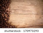 coffee beans on wood texture... | Shutterstock . vector #170973293