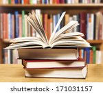 A Pile Of Books With Library O...