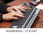 hads with manicure and computer ... | Shutterstock . vector #1711167