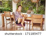 woman relaxing at home | Shutterstock . vector #171185477