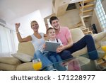 happy young family using tablet ...   Shutterstock . vector #171228977