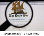 Small photo of LISBON - JANUARY 14, 2014: Photo of The Pirate Bay homepage on a monitor screen through a magnifying glass.