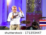 Small photo of Bangkok, Thailand - January 7, 2014: People's Democratic Reform Committee (PDRC) leader Suthep Thaugsuban on January 7, 2014 at Ratchadamnoen stage, Democracy Monument, Bangkok, Thailand.