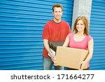 storage  couple carrying boxes... | Shutterstock . vector #171664277
