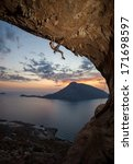 male rock climber at sunset.... | Shutterstock . vector #171698597