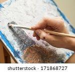Artist Paints Oil Painting On...