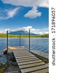 Small photo of Wooden dock on lake at the base of Mount Katahdin in Baxter State Park, Maine.