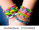 Loom Bracelets On A Young Girl...