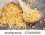 Corn In Wooden Spoon On Rustic...