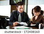 coffee shop  co workers look... | Shutterstock . vector #172438163