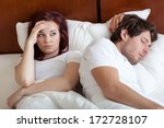 riser in bed with her sleeping  ... | Shutterstock . vector #172728107