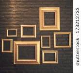 gold frame on black brick wall  | Shutterstock . vector #173212733