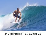 surfing a wave  | Shutterstock . vector #173230523