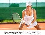 Female Tennis Player Waiting...