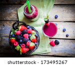 berry smoothie on rustic wooden ... | Shutterstock . vector #173495267