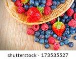 berries on wooden background | Shutterstock . vector #173535527