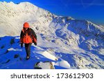 hiker on snow covered mountain...