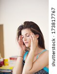 woman with headache   Shutterstock . vector #173817767