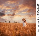 Woman In The Wheat Field