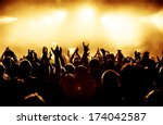 silhouettes of concert crowd in ... | Shutterstock . vector #174042587