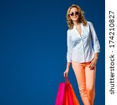 happy woman holding shopping