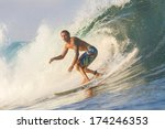 surfing a wave | Shutterstock . vector #174246353