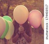 girl hiding behind the balloon   Shutterstock . vector #174403517