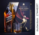 "Small photo of PETROZAVODSK, RUSSIA-February 27, 2013: Photo of bottle of ""Johnnie Walker black label"" Scotch whisky. Johnnie Walker is a brand of Scotch Whisky owned by Diageo and originated in Kilmarnock,Scotland."