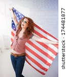 happy woman holding usa flag | Shutterstock . vector #174481877