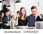 couple looking at photos on...   Shutterstock . vector #174524327