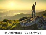 winner on the mountain top.... | Shutterstock . vector #174579497