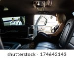 elegant woman in limousine with ...
