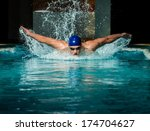 Muscular Young Man In Blue Cap...