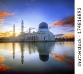 mirror reflection of the majestic mosque in kota kinabalu sabah during firery sunrise