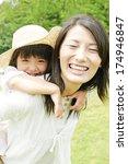 japanese girl is piggybacking... | Shutterstock . vector #174946847