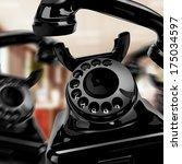black retro telephone on the... | Shutterstock . vector #175034597