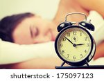 woman in bed trying to wake up... | Shutterstock . vector #175097123