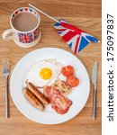 english breakfast on a wooden...