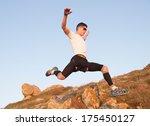 man practicing trail running... | Shutterstock . vector #175450127