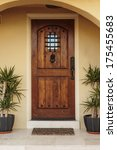 Постер, плакат: Closed ornate wood door