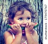 a cute girl eating watermelon... | Shutterstock . vector #175470767