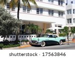 Antique automobile on ocean drive, Art Deco area of South Beach Florida - stock photo
